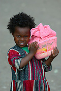 LALIBELA, WELO/ETHIOPIA..Kid at the village of Lalibela bringing home holy bread from church..(Photo by Heimo Aga)