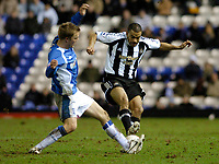Photo: Leigh Quinnell.<br /> Birmingham City v Newcastle United. The FA Cup. 06/01/2007. Newcastles Kieran Dyer jumps into a challenge with Birminghams Sebastian Larsson.