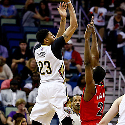Mar 18, 2016; New Orleans, LA, USA; New Orleans Pelicans forward Anthony Davis (23) shoots over Portland Trail Blazers forward Noah Vonleh (21) during the first quarter of a game at the Smoothie King Center. Mandatory Credit: Derick E. Hingle-USA TODAY Sports
