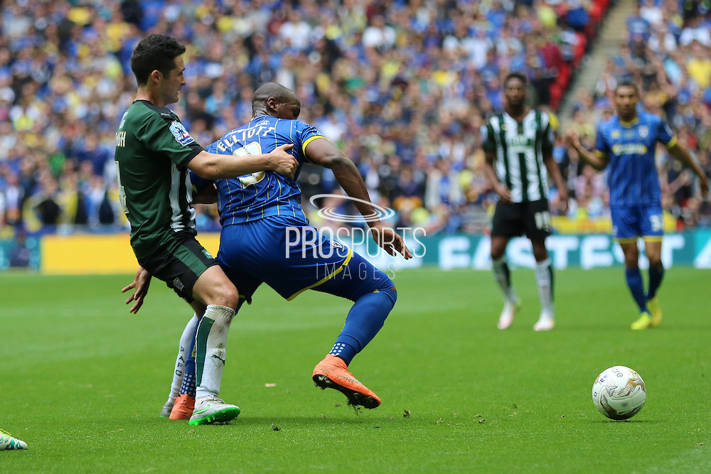 Plymouth Argyle defender Carl McHugh (4) tugs Tom Elliott forward for AFC Wimbledon (9) during the Sky Bet League 2 play off final match between AFC Wimbledon and Plymouth Argyle at Wembley Stadium, London, England on 30 May 2016. Photo by Stuart Butcher.