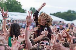 © Licensed to London News Pictures. 13/06/2014. Isle of Wight, UK.   Audience members cheers as Biffy Clyro perform live at Isle of Wight Festival .   Biffy Clyro are a Scottish rock band comprising Simon Neil (guitar/lead vocals), James Johnston (bass/vocals).  The Isle of Wight festival is an annual music festival that takes place on the Isle of Wight. Photo credit : Richard Isaac/LNP