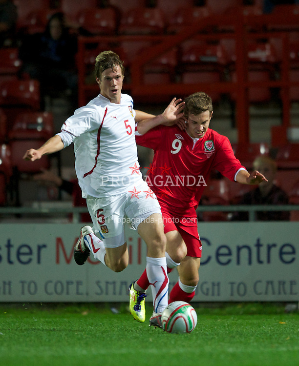 WREXHAM, WALES - Monday, October 11, 2011: Wales' Tom Bradshaw in action against Czech Republic's Tomas Kalas during the UEFA Under-21 Championship Qualifying Group 3 match at the Racecourse Ground. (Pic by Chris Brunskill/Propaganda)