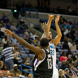 Jan 21, 2013; New Orleans, LA, USA; New Orleans Hornets power forward Ryan Anderson (33) shoots over Sacramento Kings point guard Tyreke Evans (13) during the second quarter of a game at the New Orleans Arena. Mandatory Credit: Derick E. Hingle-USA TODAY Sports