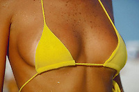 April 1986, Ipanema, Rio de Janeiro, Brazil --- Bikini Top at Ipanema Beach --- Image by © Owen Franken/CORBIS