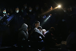 © London News Pictures. Migrants engage in a stand off with police close to the Hungarian and Serbian border town of Roszke, Hungary, September 8 2015. The UN's humanitarian agencies are on the verge of bankruptcy and unable to meet the basic needs of millions of people because of the size of the refugee crisis in the Middle East, Africa and Europe, senior figures within the UN have told the media.   Picture by Paul Hackett /LNP