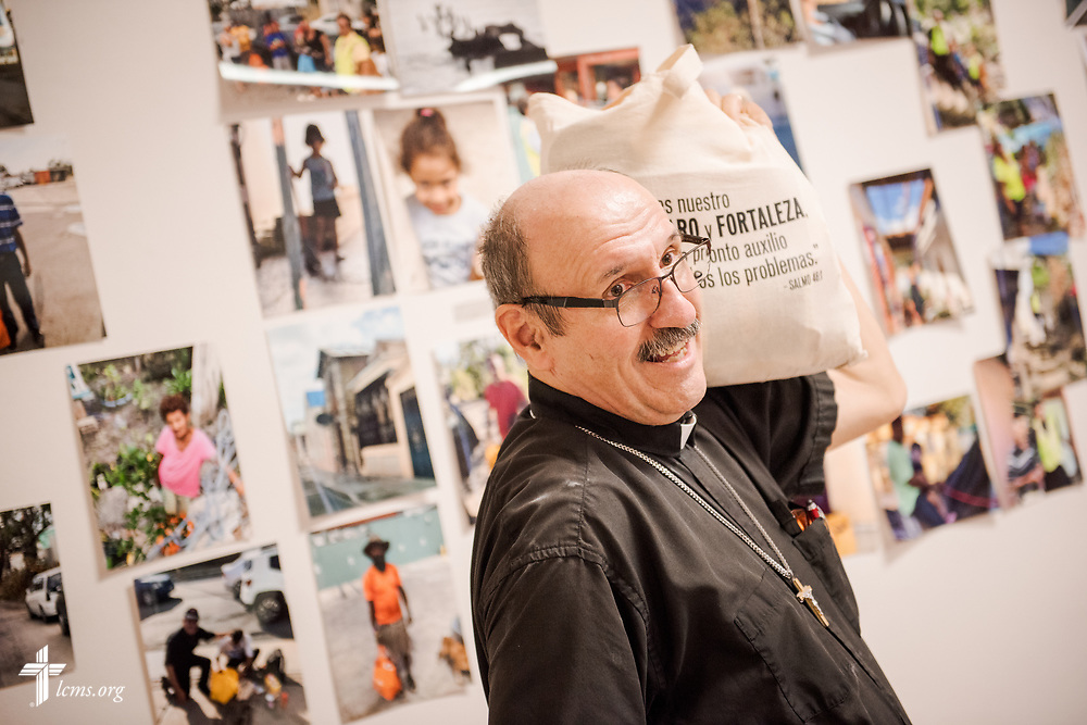 The Rev. Richard Schuller, LCMS missionary to Puerto Rico and pastor at Fuente de Vida (Fountain of Life Lutheran Church), Ponce, Puerto Rico, displays a food bag packed with food and supplies for distribution, at the church on Sunday, April 15, 2018. LCMS Communications/Erik M. Lunsford