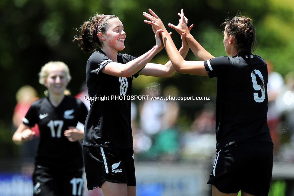 Martine Puketapu (R) of NZF Development high fives with teammate Isabella Richards after her opening goal. 2014 ASB Women's League football match, Auckland Football v NZF Development at William Green Domain, Auckland, New Zealand. Sunday 23 November 2014. Photo: Anthony Au-Yeung / photosport.co.nz