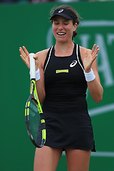 Johanna Konta reacts after a bad line call during her WTA Singles Final match with Ashleigh Barty during day seven of the Nature Valley Open at Nottingham Tennis Centre.