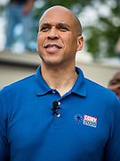 27 MAY 2019 - URBANDALE, IOWA: US Senator CORY BOOKER (D-NJ) waits to speak during a Memorial Day barbecue he hosted at his Iowa campaign headquarters. Sen. Booker is running to be the Democratic nominee for the US Presidency. Iowa traditionally hosts the the first selection event of the presidential election cycle. The Iowa Caucuses will be on Feb. 3, 2020.                  PHOTO BY JACK KURTZ