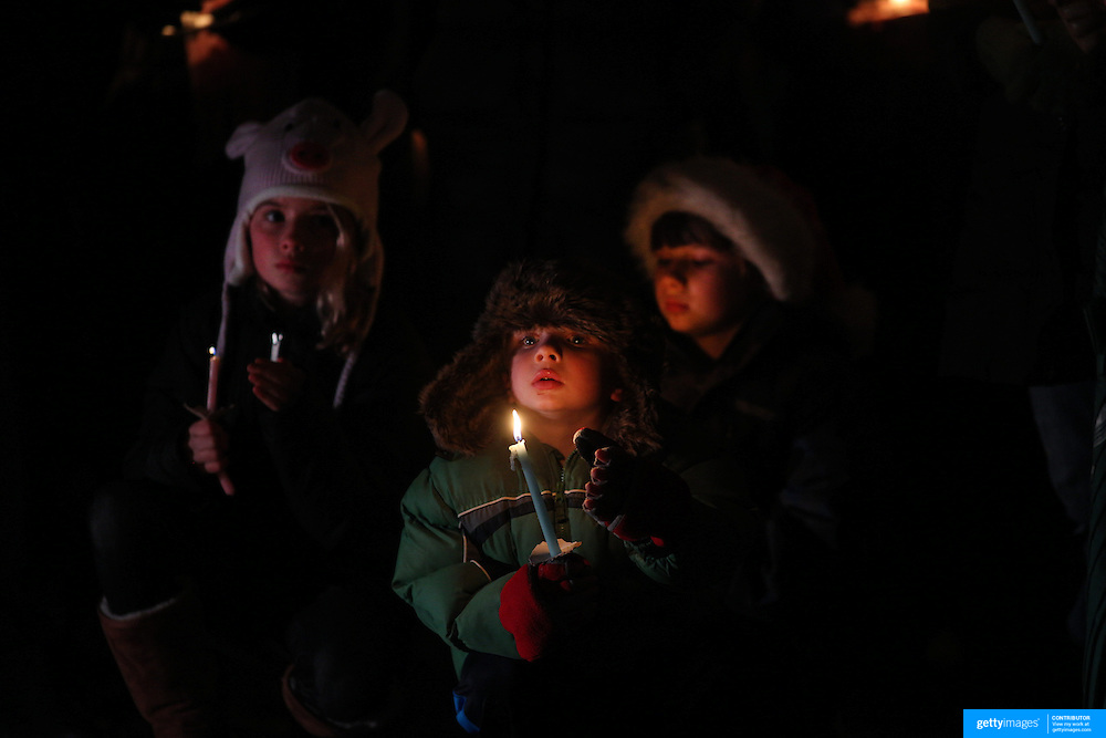 Young children at a townwide community vigil on Sherman Green. Fairfield, Connecticut after the mass shootings at Sandy Hook Elementary School, Newtown, Connecticut, USA. 17th December 2012. Photo Tim Clayton
