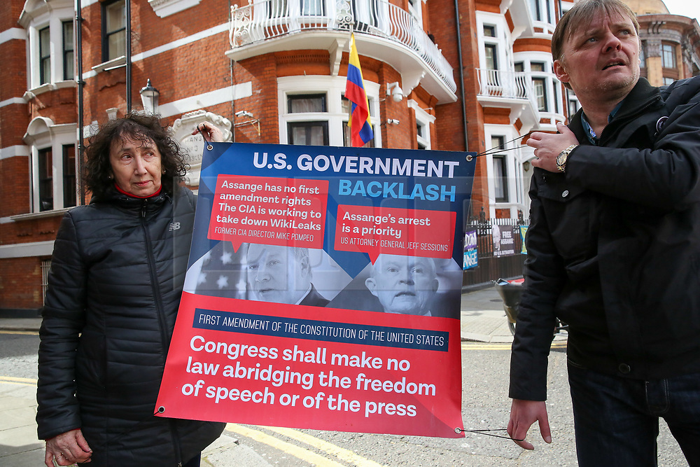 © Licensed to London News Pictures. 05/04/2019. London, UK. Supporters of Julian Assange hold a banner placard outside Ecuadorian Embassy in Knightsbridge. Media reports state that the Ecuadorian Embassy plan to remove Julian Assange, Wikileaks founder from the embassy within days. Julian Assange claimed political asylum in the Ecuadorean Embassy in June 2012 after he was accused of rape and sexual assault against women in Sweden. Photo credit: Dinendra Haria/LNP
