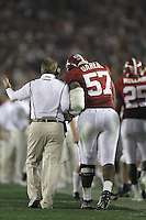 PASADENA,CA - JANUARY 07:  Marcell Dareus #57 of the Alabama Crimson Tide speaks with Nick Saban about his touchdown against the Texas Longhorns. The Crimson Tide defeated the Longhorns 37-21 in the BCS National Championship game on January 7, 2010 at the Rose Bowl in Pasadena, CA. Photo by Tom Hauck.