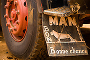 "Mud guard reading ""Bon voyage, good luck"" on the rear wheel of a large truck at the Terminal du Sahel, a large truck terminal in Lome, Togo on Wednesday October 1, 2008."