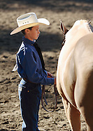 Middletown, NY - A young boy stands by his horse while competing at the Middletown Rotary Horse Show at Fancher Davidge Park on Sept. 16, 2007.