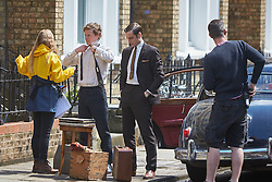 © Licensed to London News Pictures. 19/05/2015. OXFORD, UK. Filming of ITV drama Endeavour, telling the story of the early life of Inspector Morse, taking place in Wellington Square in Oxford.<br /> <br /> In this picture: Shaun Evans (2nd left)(who plays Endeavour Morse) and Jack Laskey (2nd right) (who plays DS Peter Jakes)<br /> <br /> Photo credit : Cliff Hide/LNP