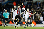 Sheffield United's David Brooks and Eunan O'Kane of Leeds United contest a loose ball during the EFL Sky Bet Championship match between Leeds United and Sheffield Utd at Elland Road, Leeds, England on 27 October 2017. Photo by Paul Thompson.