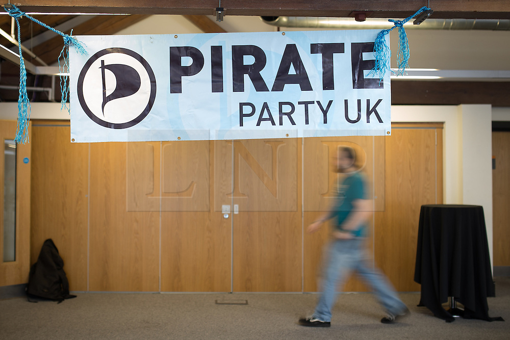 © Licensed to London News Pictures . 12/10/2013 . Manchester , UK . A conference attendee walks under a banner at the conference venue . The Pirate Party UK Conference at the Museum of Science and Industry , Manchester . The Pirate Party campaigns on Digital Rights , freedom of information , civil rights , copyright law , censorship and Internet Piracy . Photo credit : Joel Goodman/LNP