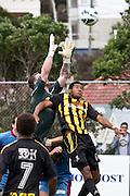 Hawkes Bay goalkeeper Andy McNeill challenged by Wellington's James Musa. Team Wellington v Hawkes Bay United, ASB Premiership semi final at David Farrington Park, Wellington. 8 March 2014. Photo: Cameron McIntosh/www.photosport.co.nz
