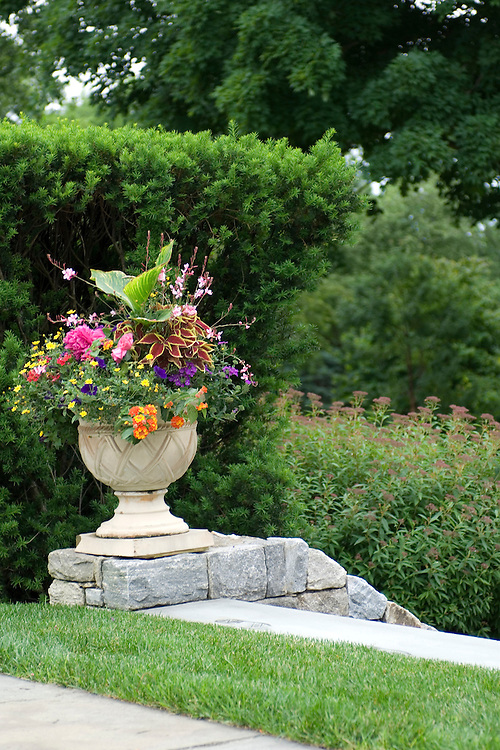 LUSH URN AT TOP OF STONE GARDEN STAIRS