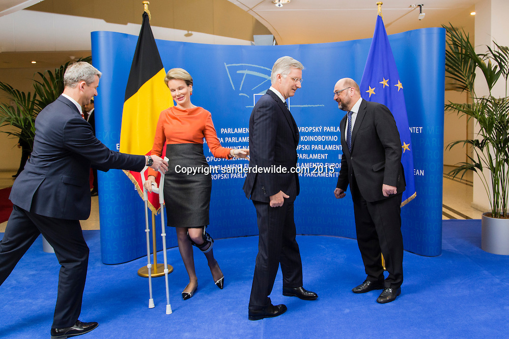Brussels 25 february 2015 President of the European Parliament Martin Schulz(R) receives King Filip (M) and Queen Mathilde (L) from Belgian at the parliament. An assistant (far left)takes over her crutches she needs after having injured her left knee due to a fall.