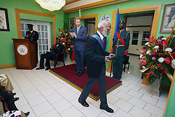 Prince Harry applauds after presenting Sir Edmund Lawrence with his GCMG during a reception hosted by Governor-General of Saint Kitts and Nevis Sir Tapley Seaton at Government House, Basseterre, during the second leg of his Caribbean tour.