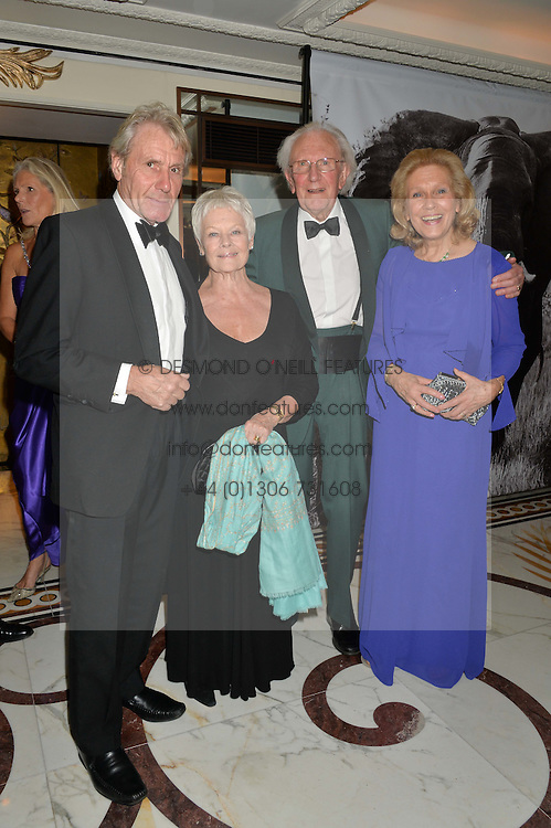 Left to right, DAVID MILLS, DAME JUDI DENCH, DAVID SHEPHERD and AVRIL SHEPHERD at the David Shepherd Wildlife Foundation 30th anniversary Wildlife Ball at The Dorchester, Park Lane, London on 10th October 2014.