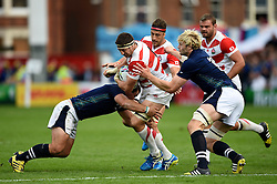 Luke Thompson of Japan takes on the Japan defence - Mandatory byline: Patrick Khachfe/JMP - 07966 386802 - 23/09/2015 - RUGBY UNION - Kingsholm Stadium - Gloucester, England - Scotland v Japan - Rugby World Cup 2015 Pool B.
