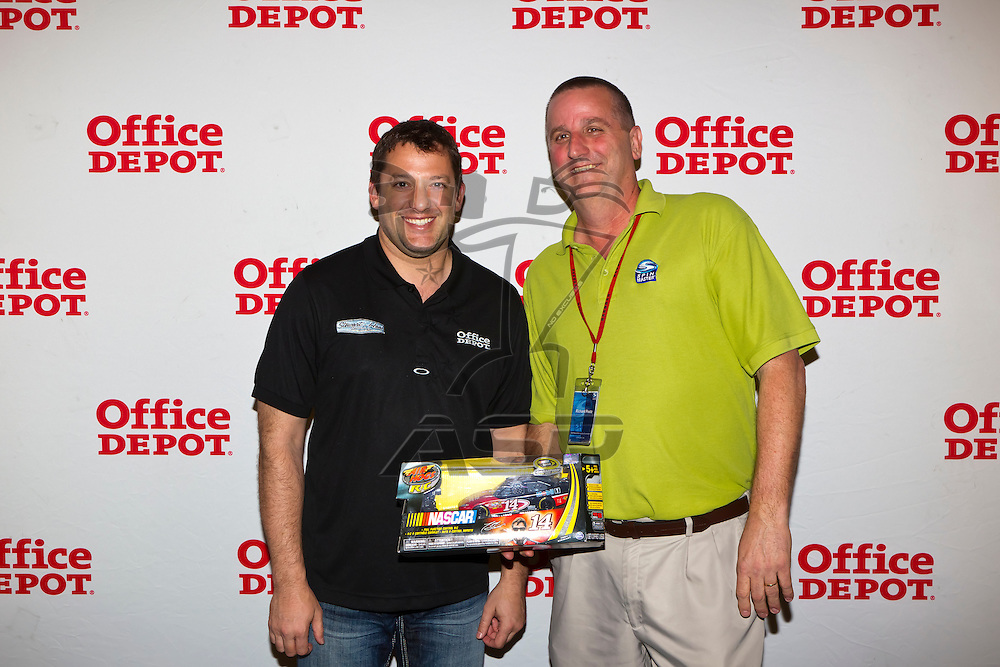 Rancho Cucamonga, CA - MAR 22, 2012:  Tony Stewart (14) signs autographs for fans at the Office Depot Store in Rancho Cucamonga, CA.