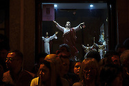 People on the outside religioous merchandise shop attending Ecce Homo procession