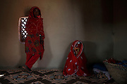 In a remote village in Sindh Province near the border with India a young teenage girl takes part in her own wedding ceremony. As is the custom of Sindh she will remain in this one room house for three days dressed in red and totally covered to all but female eyes until all the customs are complete and she can join her husband.