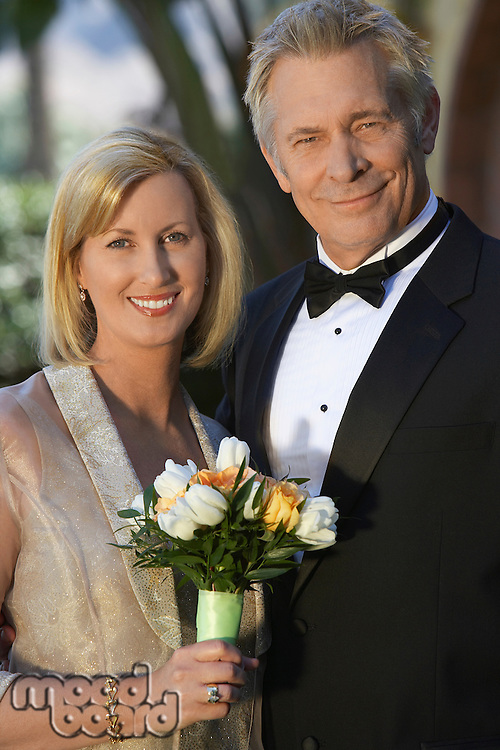 Middle-aged couple in formal wear, portrait
