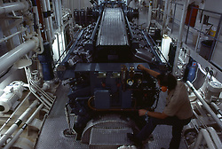 Stock photo of a man operating machinery in a processing plant