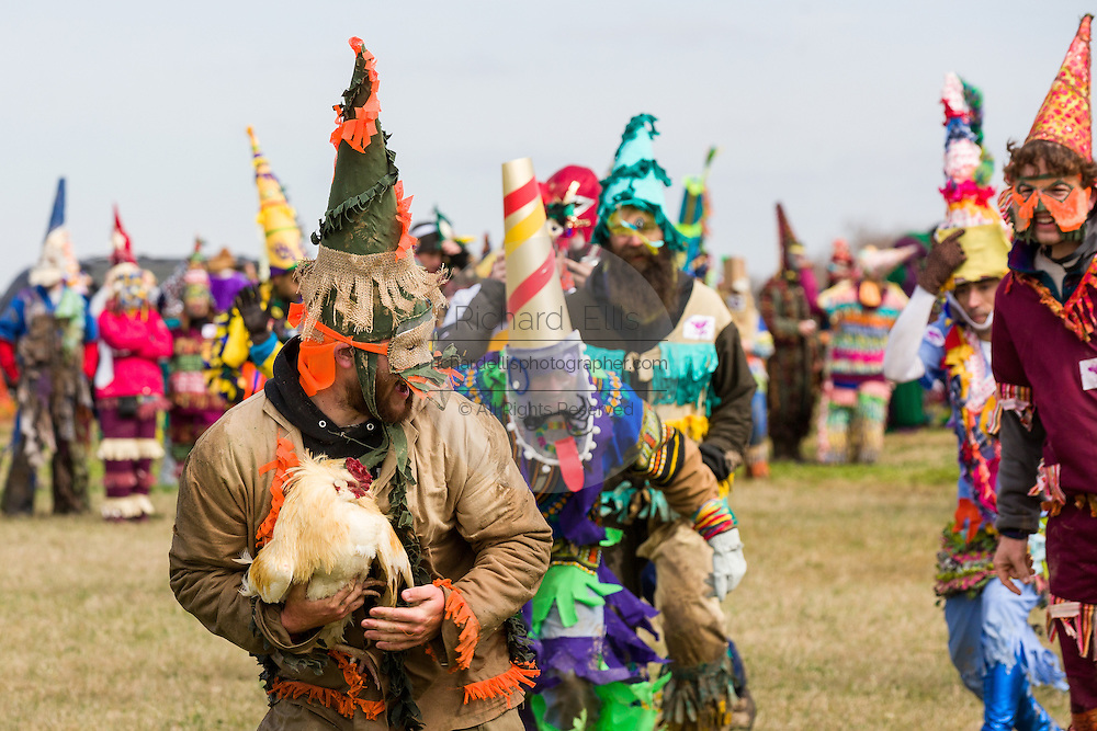 Costumed revelers race after a live chicken during the Faquetigue Courir de Mardi Gras chicken run on Fat Tuesday February 17, 2015 in Eunice, Louisiana. The traditional Cajun Mardi Gras involves costumed revelers competing to catch a live chicken as they move from house to house throughout the rural community.