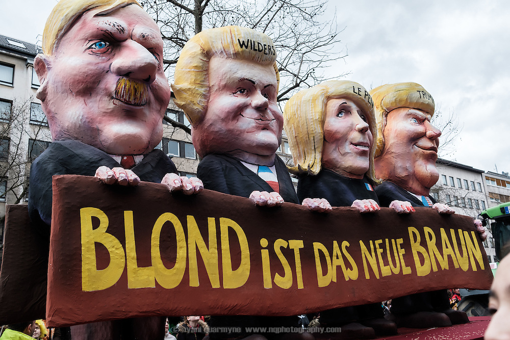 "A float featuring caricatures of Adolf Hitler, Geert Wilders, Marine Le Pen and Donald Trump and the words, ""Blond is the New Brown"" during the traditional Karneval parade in Düsseldorf, Germany on 27 February 2017."