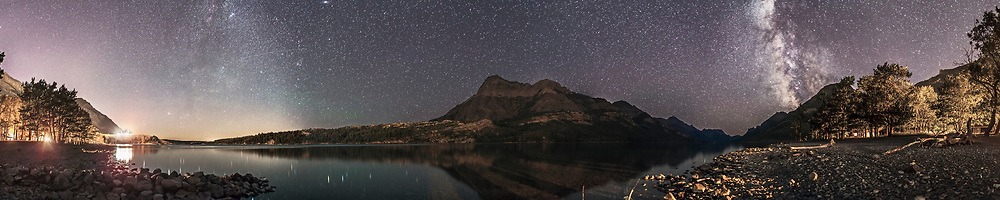 A 9-section 270° panorama of Waterton Lakes, the Upper Lake, looking from north (left) to southwest (right), taken on a very clear night August 31, 2013. Each section is 45-seconds with the 24mm lens at f/2.5 and Canon 5D MkIi at ISO 2500. Stitched in Photoshop.