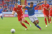 Walsall midfielder Shaun Donnellan (23) battles with Oldham Athletic striker Aaron Amadi-Holloway (10) 0-0 during the EFL Sky Bet League 1 match between Walsall and Oldham Athletic at the Banks's Stadium, Walsall, England on 12 August 2017. Photo by Alan Franklin.