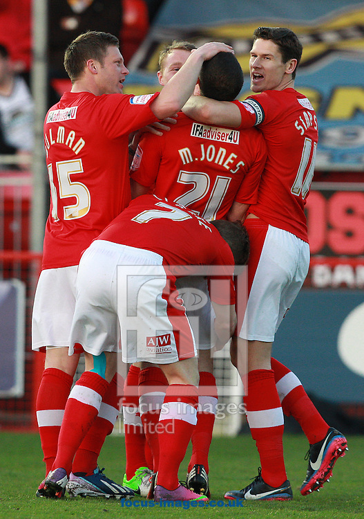 Picture by Paul Terry/Focus Images Ltd +44 7545 642257.23/04/2013.Mike Jones ( C ) of Crawley Town celebrates with team mates after scoring the opening goal during the npower League 1 match at Broadfield Stadium, Crawley.