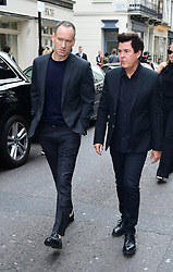 Simon Fuller (right) arrives to attend the Victoria Beckham London Fashion Week SS19 show in Dover Street, London.