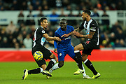 Ngolo Kante (#7) of Chelsea squeezes between the challenges of Isaac Hayden (#14) of Newcastle United and Jamaal Lascelles (#6) of Newcastle United during the Premier League match between Newcastle United and Chelsea at St. James's Park, Newcastle, England on 18 January 2020.