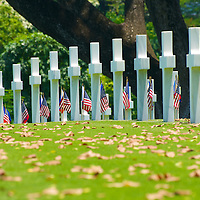 Among the scattered leaves are the graves of thousands of American and Filipino soldiers killed during the Second World War in the Pacific