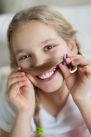 Girl making mustache with hair