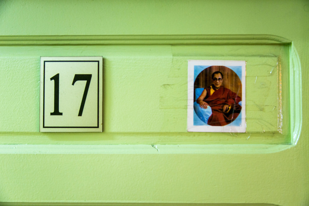 """A photograph of the Dali lama is taped to at door in the Gandantegchinlen Monastery, known as the Gandan Monastery, a Tibetan-style monastery in the Ulaanbaatar Mongolian, on July 23, 2012.  The Tibetan name translates to the """"Great Place of Complete Joy."""" It currently has over 150 monks in residence. The Gandan Monastery was renovated in 1990 following the collapse of the communist government in Mongolia. © 2012 Tom Turner Photography"""