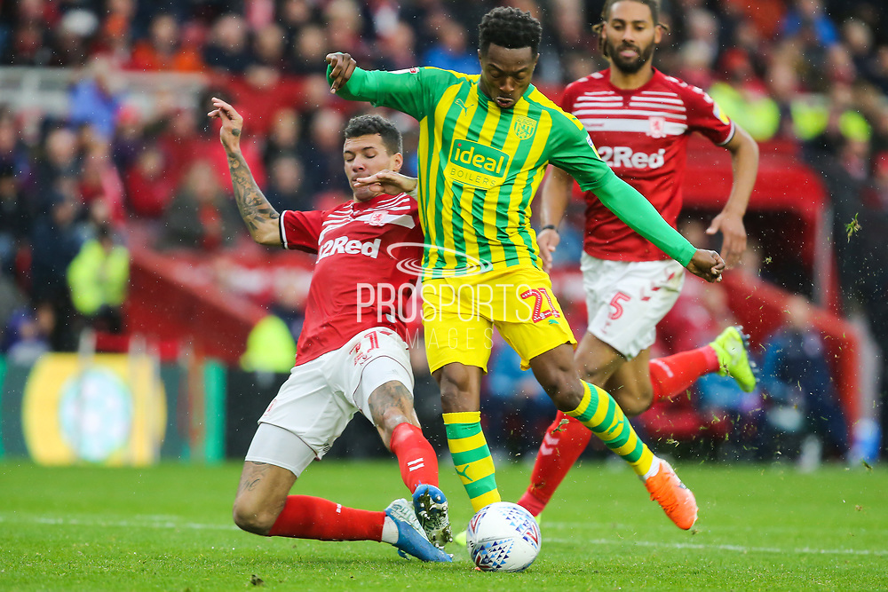 Middlesbrough midfielder Marvin Johnson (21) makes a last minute challenge on West Bromwich Albion forward Kyle Edwards (21) when through on goal during the EFL Sky Bet Championship match between Middlesbrough and West Bromwich Albion at the Riverside Stadium, Middlesbrough, England on 19 October 2019.