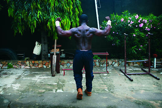 Ghana, Accra. a body builder at one of the many local gyms.
