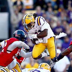 November 17, 2012; Baton Rouge, LA, USA; LSU Tigers running back Spencer Ware (11) leaps over the goal line for a touchdown during the first half of a game against the Ole Miss Rebels at Tiger Stadium.  Mandatory Credit: Derick E. Hingle-US PRESSWIRE