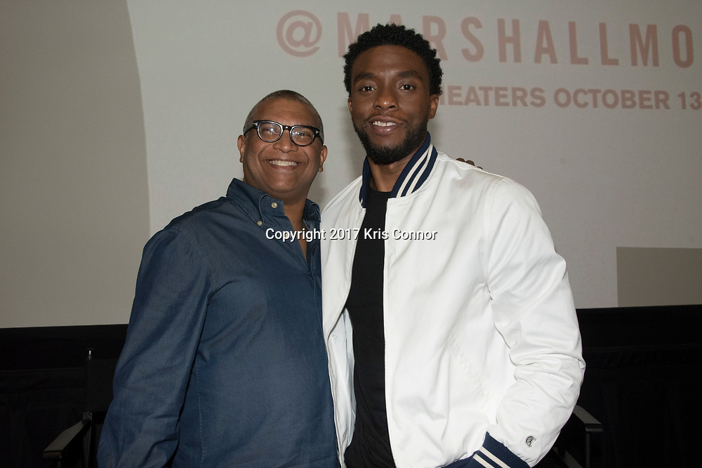 Director Reginald Hudlin, and actor Chadwick Boseman  pose for a photo during a Q&A session after a screening of Open Road Films' new movie MARSHALL at in Baltimore, Md. on July 25th, 2017. (Photo by Kris Connor/Open Road Films)