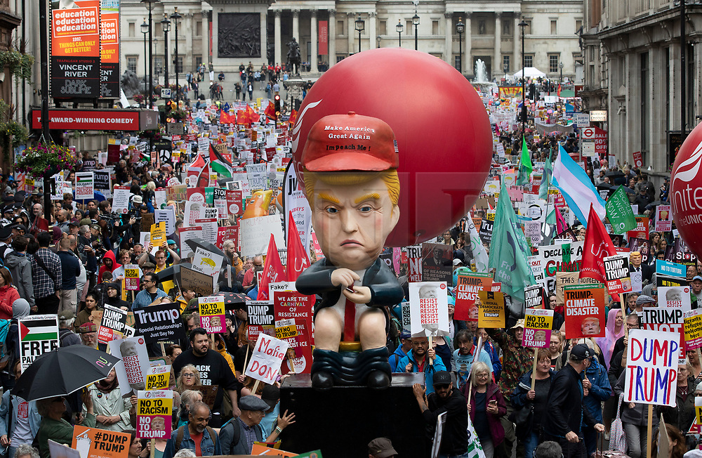 © Licensed to London News Pictures. 04/06/2019. London, UK. A giant effigy of US President Donald Trump is carried by protestors as they make their way down Whitehall in central London. On the 2nd day of President Trump's State Visit to the UK he is meeting outgoing Prime Minister Theresa May before attending 75th Anniversary of D-Day commemorations in Portsmouth and France tomorrow. Photo credit: Peter Macdiarmid/LNP