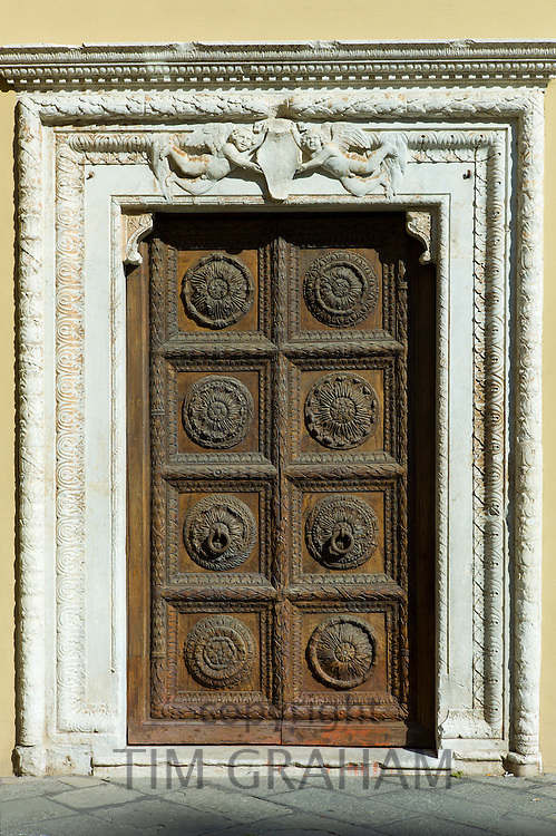 Ancient traditional doorway of Curia Arcivescoville in Piazalle Mons Giulio Arrigoni, in Lucca, Italy