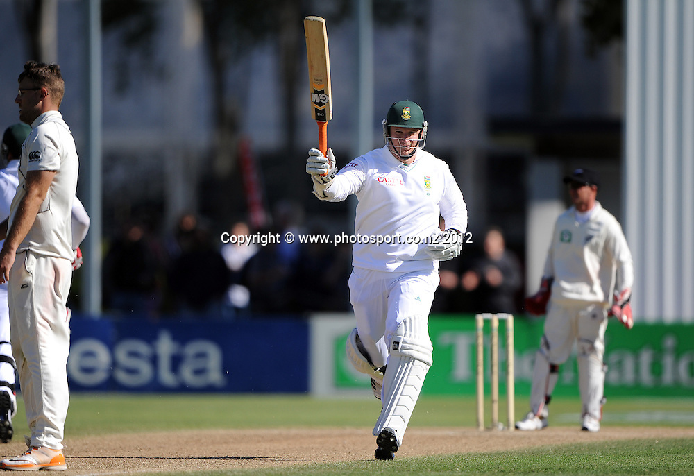 South African captain Graeme Smith celebrates his century on Day 3 of the first test match between South Africa and New Zealand at the University Oval in Dunedin, New Zealand on Friday 9 March 2012. Photo: Andrew Cornaga/Photosport.co.nz