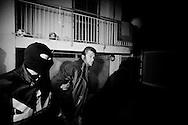 Napoli, Italia - 4 marzo 2010. L'arresto di Mario Veneruso. Un'agguerrita organizzazione camorristica dedita alle estorsioni e all'usura ai danni di imprenditori e commercianti di Volla e Casalnuovo, nel Napoletano, è stata smantellata da un`operazione congiunta di Dia e carabinieri denominata &laquo;Luna Rossa 2&raquo;. Gli agenti della DIA e dei Carabinieri del comando provinciale di Napoli hanno arrestato sei persone.<br /> Ph. Roberto Salomone Ag. Controluce<br /> ITALY, Naples - Arrest of Mario Veneruso.Antimafia and Carabinieri forces arrested 6 people linked to neapolitan mafia organisation of camorra on March 4, 2010.
